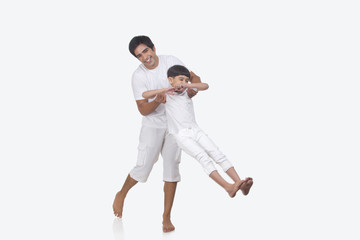 Portrait of father and son enjoying