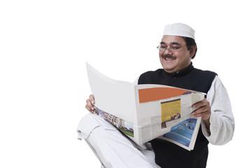 Happy politician reading newspaper