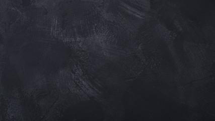 Closeup of dark grunge textured concrete background