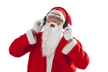 Santa Claus listening to music from headphones over white background