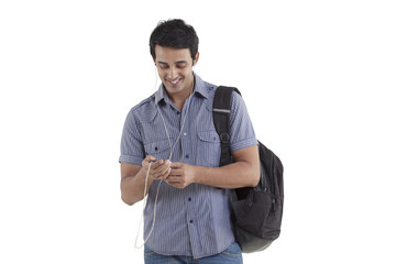 Young man smiling and listening to music