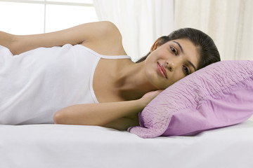 Young girl lying in bed