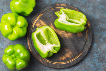 Bell peppers on cutting board. Culinary background. Top view, space for text.