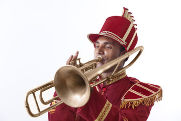 Bandmaster playing on a trumpet