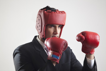 Businessman with boxing gloves in boxing stance