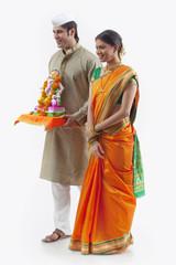 Maharashtrian couple with a Ganesh idol