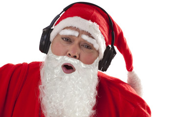 Close up of Santa Claus enjoying music over white background