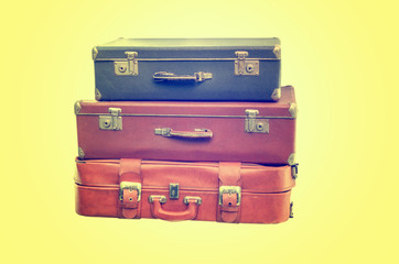 Vintage Suitcase over a yellow background
