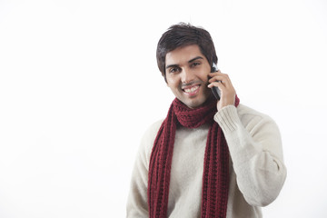 Portrait of young man talking on cell phone