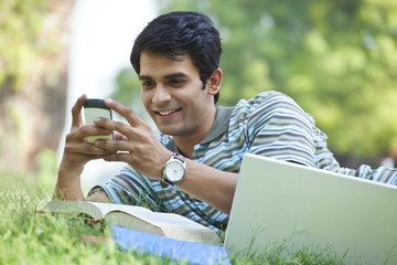 Student sending a text message on mobile phone