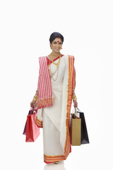 Portrait of Bengali woman carrying shopping bags