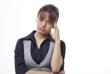 Worried young businesswoman over white background