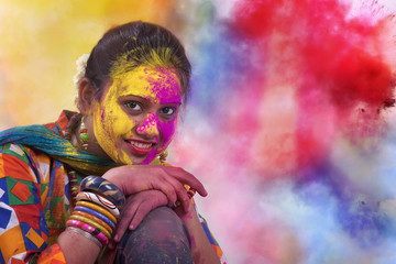 Portrait of  young Indian Woman celebrating Holi color festival