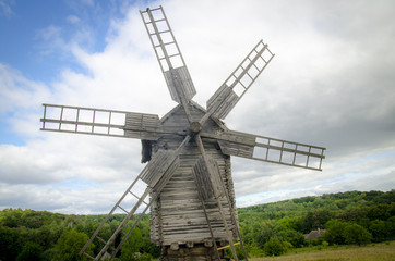 Photo sur Toile Moulins Wooden windmill in the forest