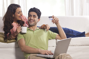 Married couple with credit card and laptop