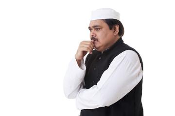 Mature politician contemplating