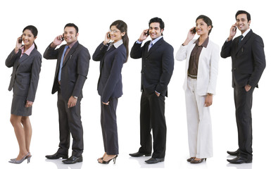 Business executives talking on a mobile phone