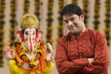 Portrait of a man with a Ganesh idol