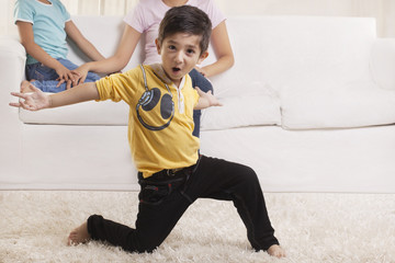 Little boy dancing with family in the background