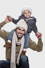 Son and father in playful mood white background