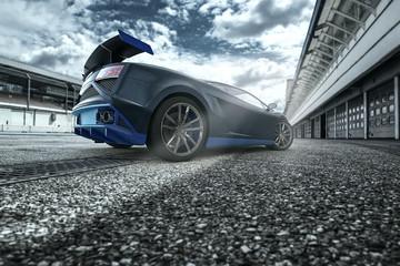 Schwarz blauer Supersport GT Rennagen in einer Boxengasse