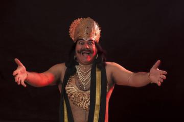 Man dressed as Raavan gesturing