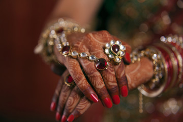 Close-up of bridal hands with henna tattoo design
