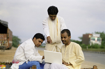 Rural men with a laptop