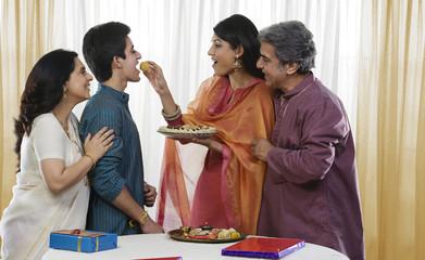 Girl feeding her brother during Rakhi