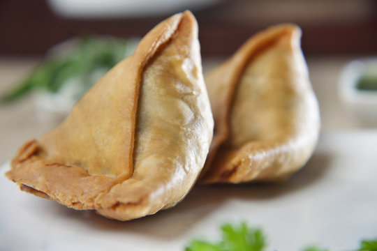 Close-up of two samosas in plate