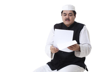 Male politician reading documents over white background