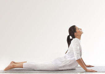 Woman practicing yoga - upward dog