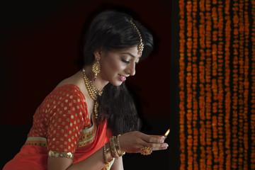 Woman holding a diya