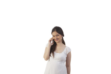 Pregnant woman talking on the mobile phone