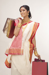 Bengali woman with shopping bags