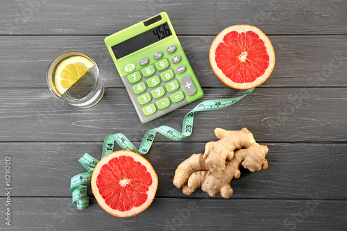 diet concept calculator measuring tape and different groceries on