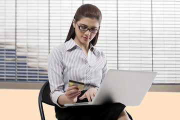 Secretary with a credit card and laptop