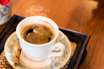 A cup of  coffee  on the wooden  table.