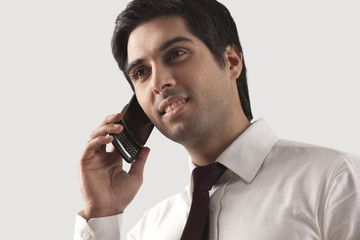 Handsome young businessman speaking on cell phone