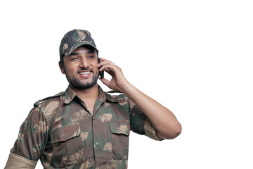 Happy soldier having conversation on mobile phone