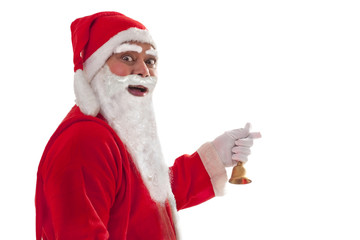 Side view of cheerful Santa Claus with bell over white background