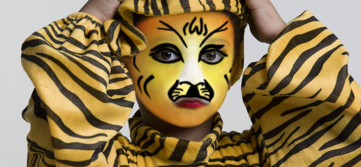 Boy in a tiger costume