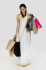 South Indian woman with shopping bags