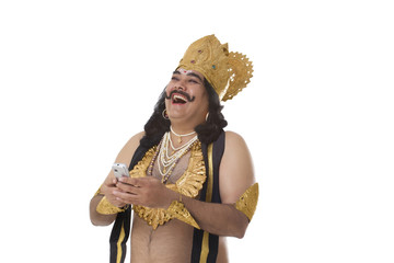 Man dressed as Raavan with a mobile phone laughing