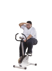Obese man on exercise bike