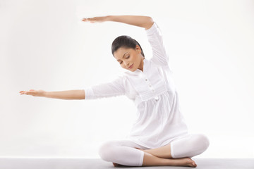 Young woman in casual clothes practicing yoga