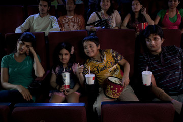 People getting bored during a movie