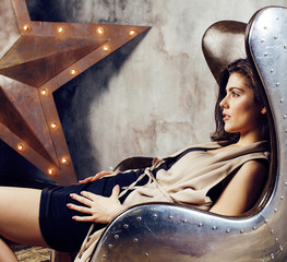 young pretty woman waiting alone in modern loft studio, hipster modern girl, fashion musician concept, lifestyle people