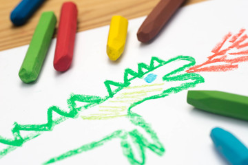 child drawing, dragon , selective focus