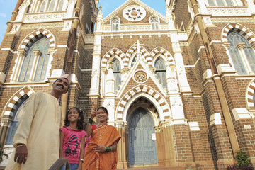 Maharashtrian family standing in front of a church